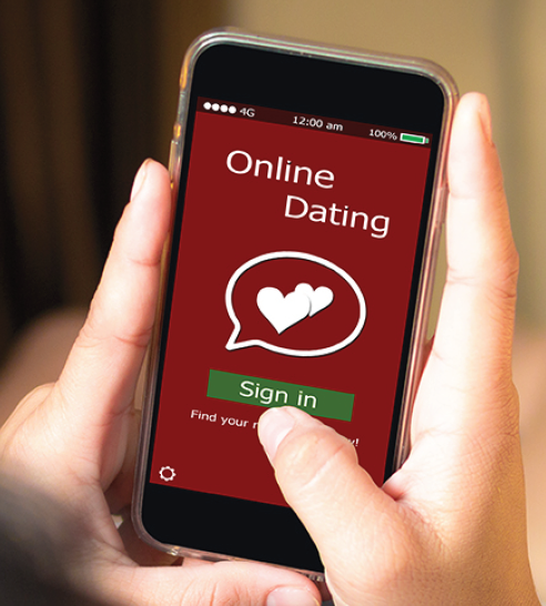 Hand holding cell phone to sign in to online dating site